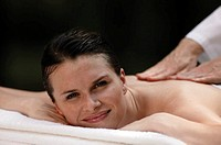 Woman receiving massage, portrait