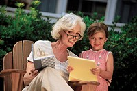 Grandmother reading to Granddaughter