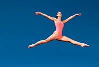 Woman jumping, blue background