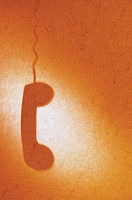Silhouette of telephone receiver and cord