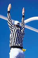 Referee signaling a touchdown