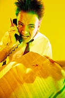 Character businessman on phone holding stock pages