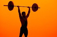 Male silhouette lifting weights