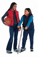 Girls with basketball and scooter
