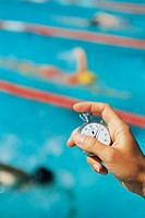 Swimming coach holding a stopwatch