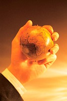 Businessman´s hand holding globe, focus on African continent
