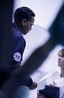 Paramedic talking to nurse