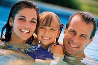 Family in pool, portrait
