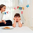 Boy and girl at birthday party