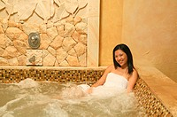Smiling woman in hot tub