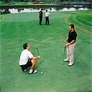 Men playing golf