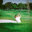 Golfer in sand trap