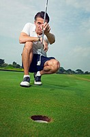 Man holding putter