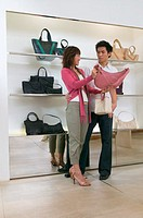 Couple shopping for handbag (thumbnail)