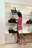 Woman shopping for a handbag (thumbnail)