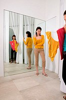 Two women in clothes store (thumbnail)