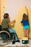 Disabled mother and daughter decorating