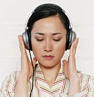 Businesswoman Listening to Her Headphones With Her Eyes Closed