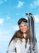 Female Skier Standing with Skis