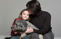 Portrait of Bearded Collie/ Wheaton and Owners