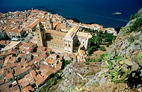 Medieval old town of Cefalù with its Norman cathedral begun in AD 1131 by the Norman king Roger II seen from the Rocca. Cefalù. Sicily, Italy