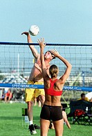 Voleyball action featuring male and female