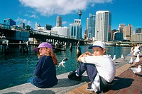 Kids having a rest. Darling Harbour. Business district. Downtown. Sydney. Australia.