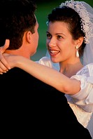 Bride hugging her groom (thumbnail)