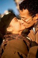 Young couple kissing with their eyes closed (thumbnail)