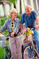 Senior couples standing with bicycles