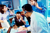 Business executives on the phone in a meeting