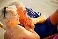 Senior couple lying on the beach