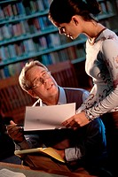 Teenage girl giving a man a document