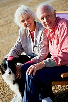 Portrait of a senior couple sitting with a dog