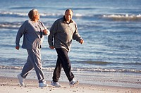 Senior couple walking at the beach