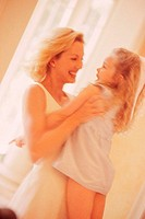 Young woman lifting up her daughter (thumbnail)