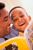 Close-up of a father reading to his son