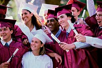 Group of teenagers holding their degrees on graduation day (thumbnail)