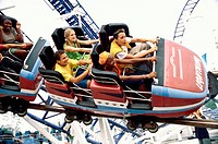 High angle view of teenage boys and girls on a roller coaster ride