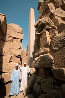Caretakers pose for a photo near the obelisk at Karnak. Luxor. Egypt