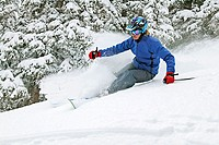 Woman skiing in Taos, New Mexico. USA