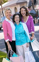 Three Generation of Women Outdoors Holding Shopping Bags