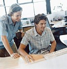 Two Businessmen Working at a Desk