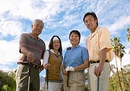 Portrait of Four Smiling People Standing on a Golf Course