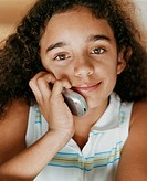 Close-up Portrait of a Young Girl Using a Mobile Phone