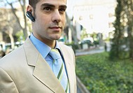 Smart Businessman Wearing a Hands-Free Device