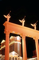 Pillars that support trumpeting statues display frame Caesar´s Palace hotel and casino. Las Vegas. Nevada, USA