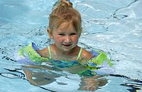Little girl in a pool
