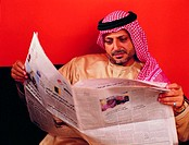 Arab man reading Arabic newspaper (thumbnail)