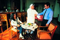 Arab business meeting in a cafe